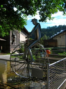 Tin Man Bicyclist waterwheel scupture. ; two wheel travel