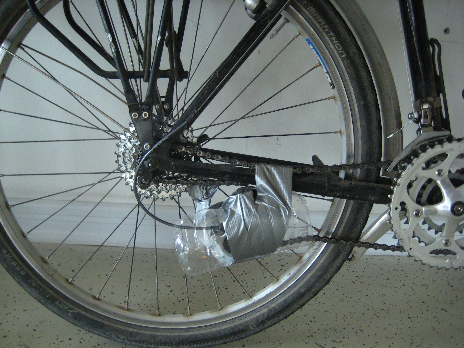remove the rear derailleur; bike touring; cycling; air travel; flying with a bike