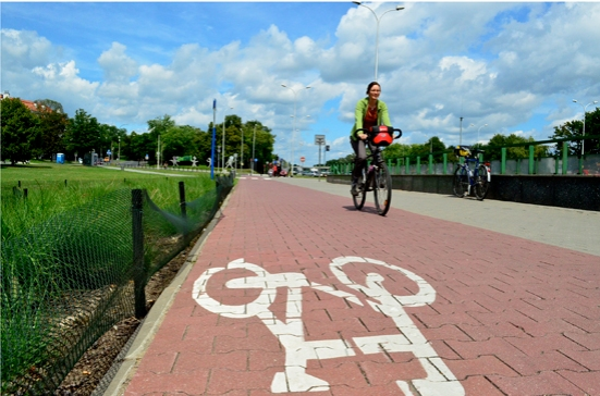 Cycling on the cycle track along the west side of the Wisła (Vistual) rive in Warsaw Poland; Two Wheel Travel